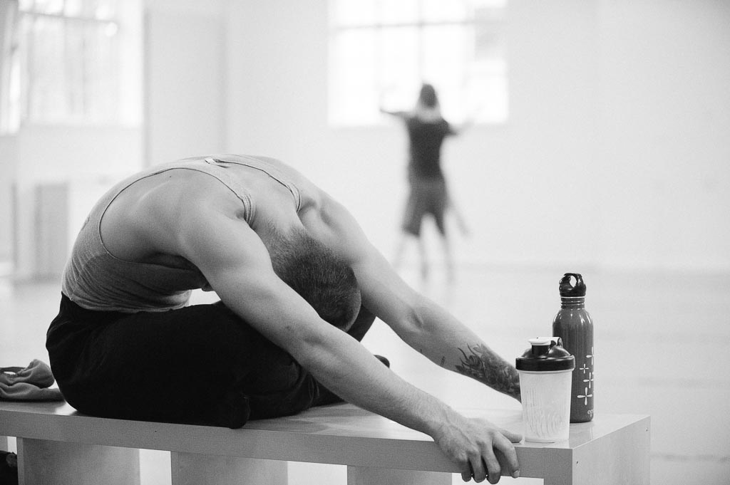 Franco Nieto of Northwest Dance Project stretches before rehearsal.