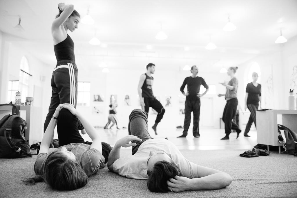 Dancers stretch between rehearsals at Northwest Dance Project